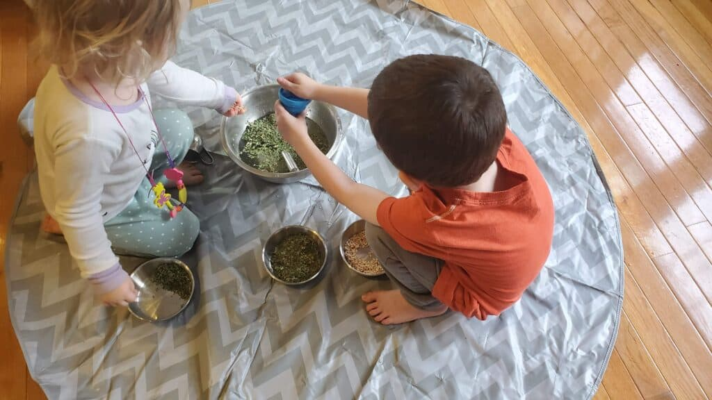Herbs, water, and funnels make a great nature-based playtime in our preschool homeschool routine.